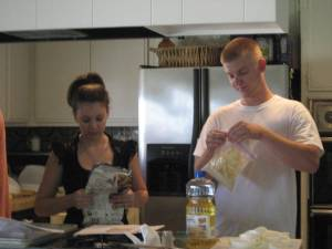 Laura reads the recipe, Ryan prepares cracker crumbs