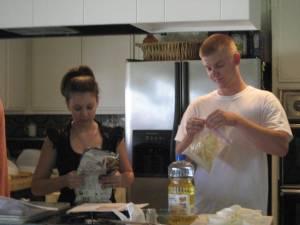 Laura reads the recipe, Ryan prepares cracker crumbs